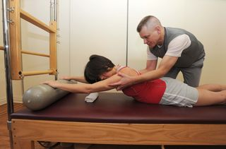Shoulder girdle stabilization - triceps muscle toning - home fitness exercise for low back pain- Herald -