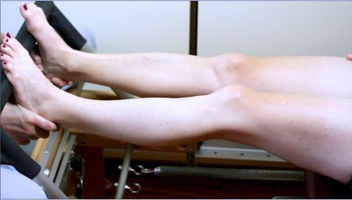 Leg fully lengthened - knee joint health - Pilates reformer exercises - Pilates feet