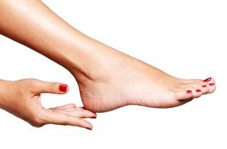 Closeup photo of a female feet with beautiful red pedicure © Valua Vitaly - Fotolia.com -M